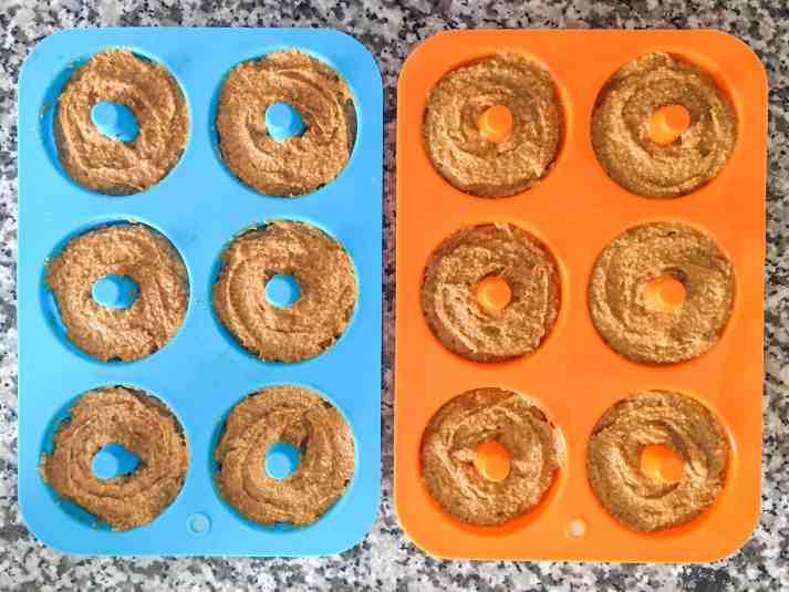 donut batter in pans before baking