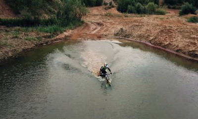 Watch this electric motorcycle ride through a pond