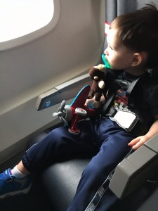 A toddler enjoys his first flight on an international trip to Spain.p to