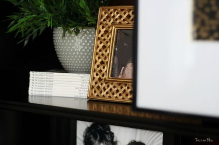 how to update an old bookcase with command hooks - 30 second makeover - formal living room bookcase - hanging art on a bookcase - chatbooks - This is our bliss
