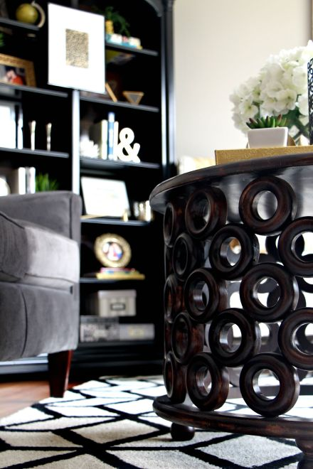 how to update an old bookcase with command hooks - 30 second makeover - formal living room bookcase - hanging art on a bookcase - formal living room coffee table - This is our bliss