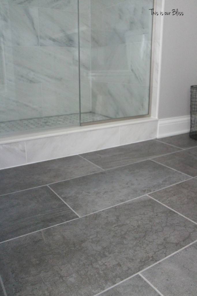 TIOB basement project - basement bathroom - marble tile & gray tile floor - This is our Bliss