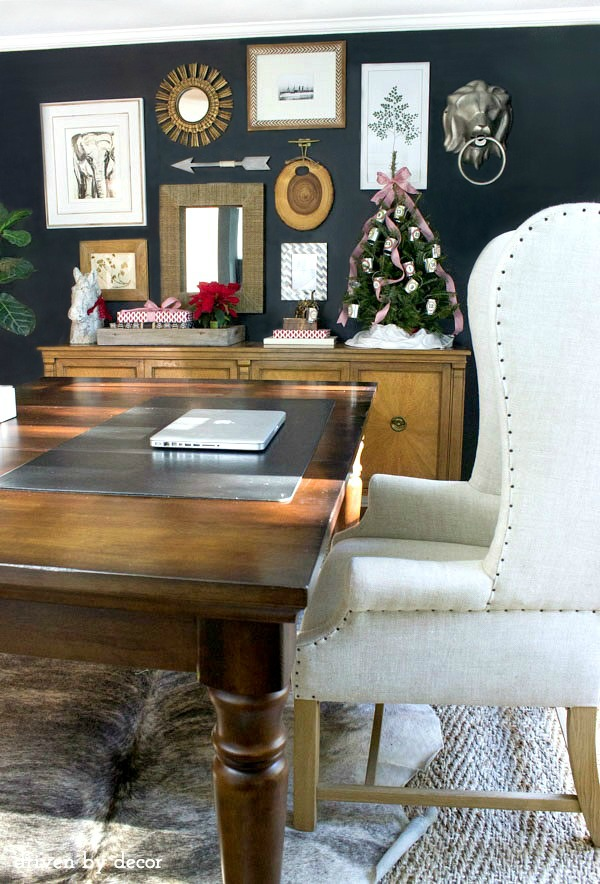 Our-home-office-decorated-for-the-holidays-gallery-wall-wrapped-gifts-advent-tree-World-Market-table-cowhide-rug-jute-rug-and-wingback-chair