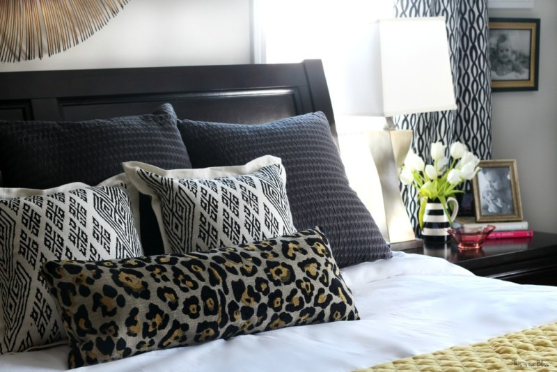 New year new room master bedroom refresh challenge - pattern play bedroom leopard pillow with black and white accents nightstand styling This is our Bliss www.thisisourbliss.com
