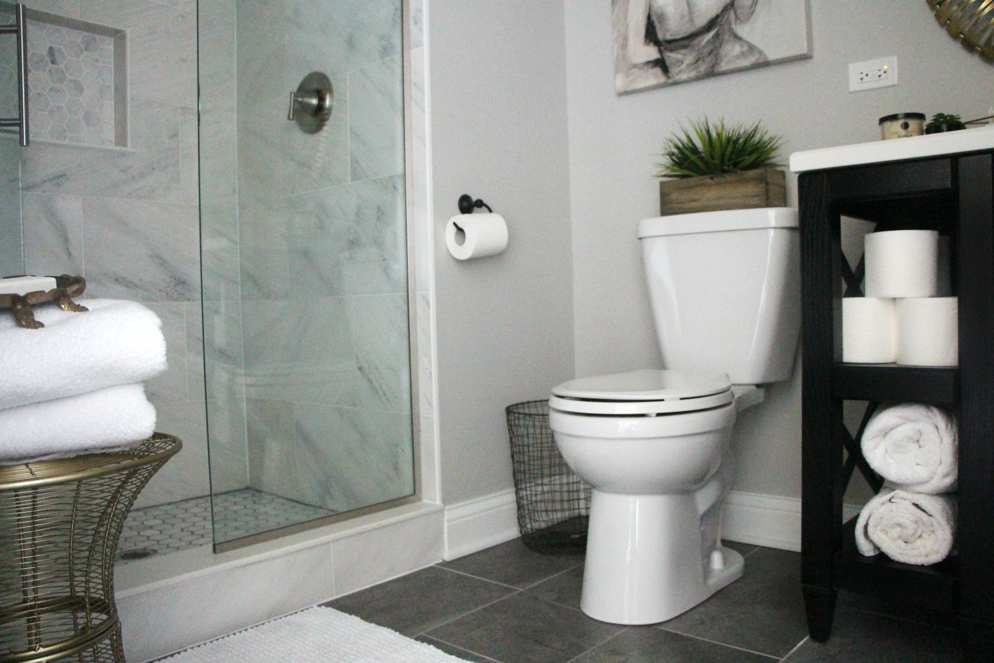 How to create a neutral glam bathroom for Black and grey bathroom tiles