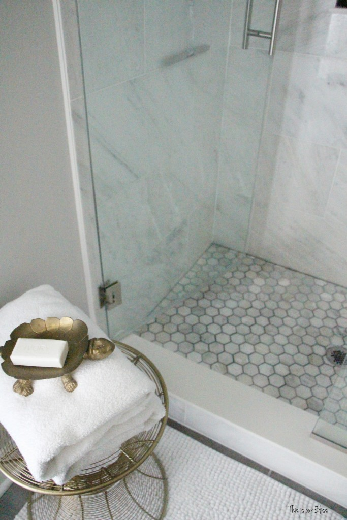 Basement bathroom reveal | Marble shower hexagon shower tile | neutral bathroom decor | black, white gold and gray glam bathroom || This is our Bliss