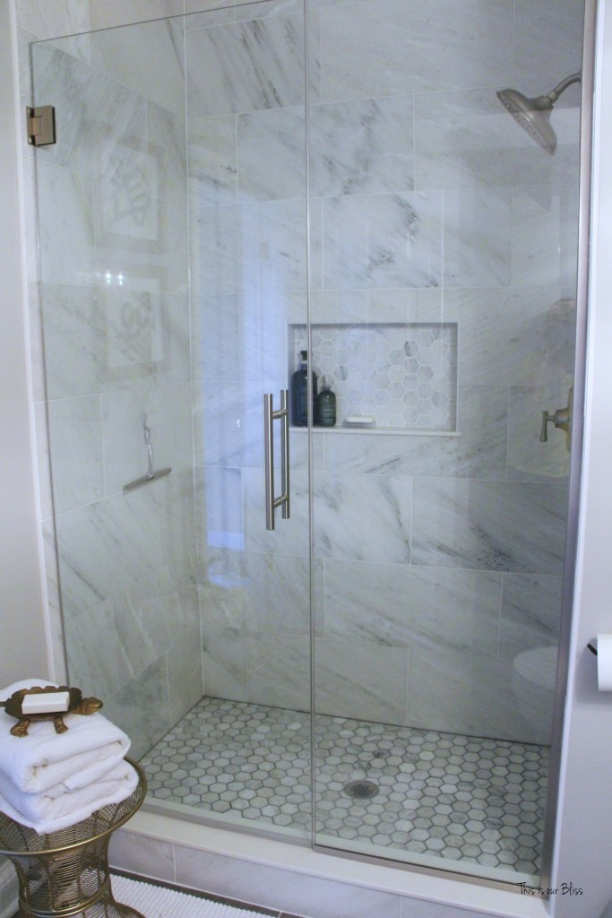 Basement bathroom reveal | neutral glam bathroom decor | marble shower | hexagon tile shower 1 || This is our Bliss