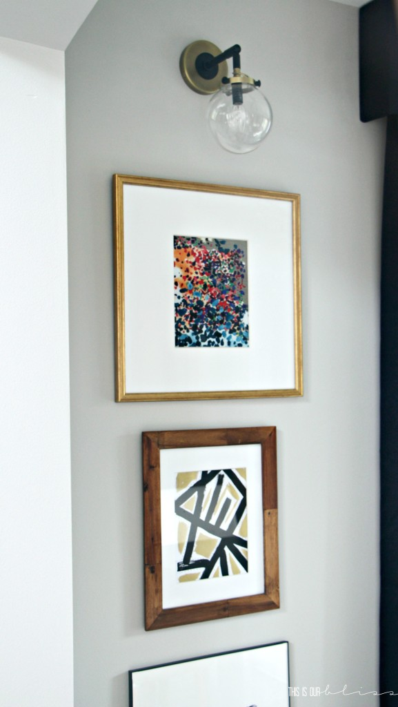 stacked-frames-under-sconces-dining-room-art-display-this-is-our-bliss