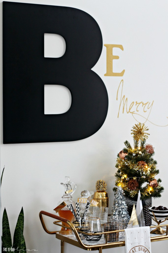 A Merry and Metallic Christmas Home | 12 Days of Holiday Homes Tour 2016: This is our Bliss Christmas Living Room with holiday B ar Cart with Metallic Accents || www.thisisourbliss.com