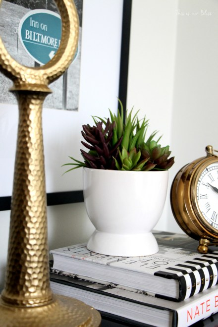 Guestroom revamp - bedside table - gold lamp & clock - succulent - design books- This is our Bliss