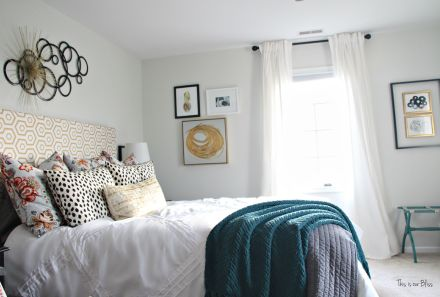how to layer wall art - wide shot of bed & window wall - Guestroom revamp - pattern play - floral, dalmation, geo, gold - This is our Bliss