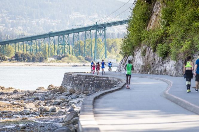 People running along the Seawall in Vancouver