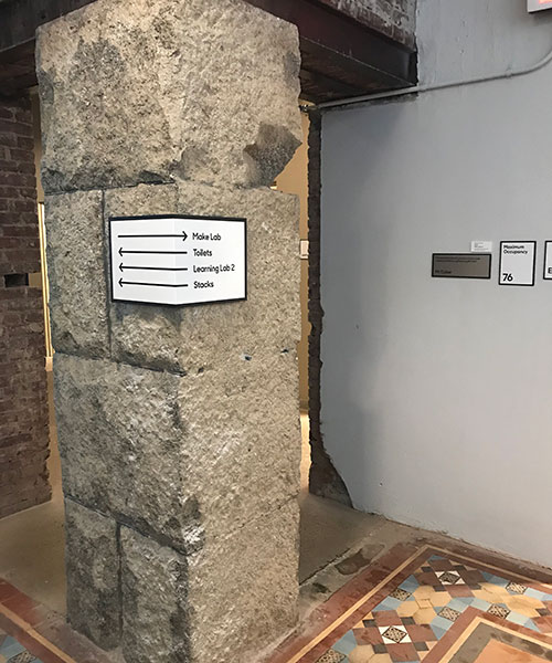 MuseumLab's interior signage wrapping around column