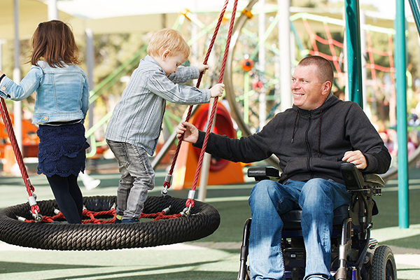person in wheelchair at a playground