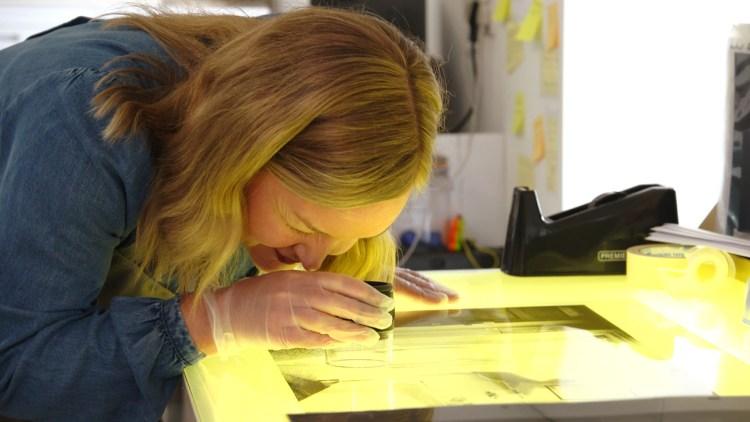 Artist Jean Curran at work on her dye transfer printing