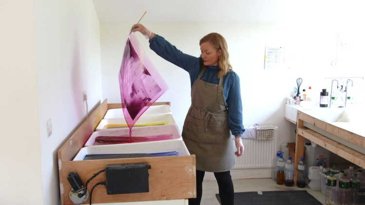 Artist Jean Curran in her Waterford studio. Image from RTE Nationwide.