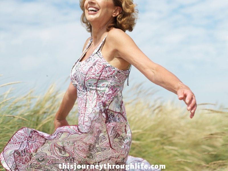 woman happy, smiling, dancing in field - TJTL - weight loss and increased energy information