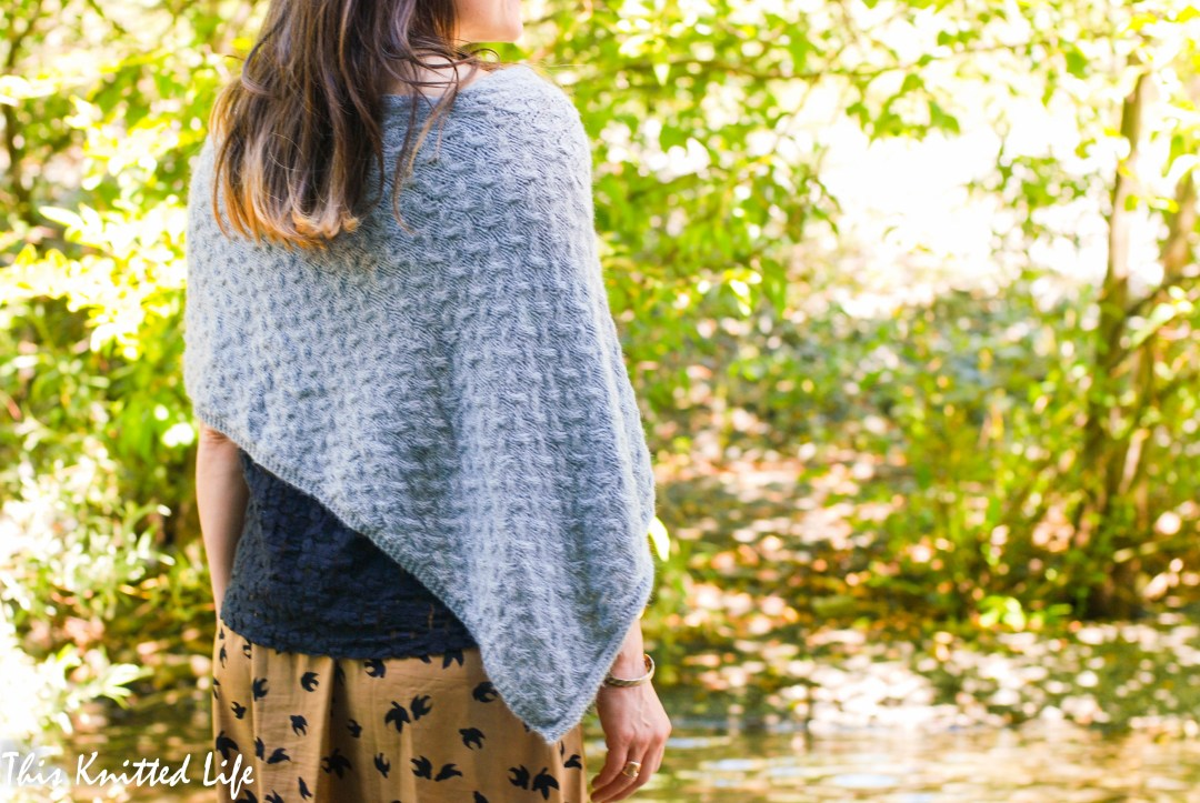 Stoneland Poncho by This Knitted Life. Knit in 100% alpaca Puna Amona sportweight. This easy folded-style poncho is knit in a simple cable fabric stitch for texture without being overly-complicated.