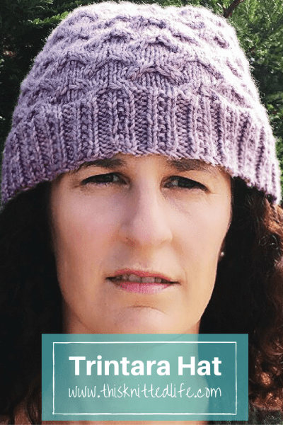 trintara-hat-knitting-pattern-using-madelinetosh-pashmina-worsted-in-sugar-plum-on-us-size-7-needles. The modified cable brim transitions into an easy cabled fabric with tons of dimensionality but not too much fuss. Happy knitting!