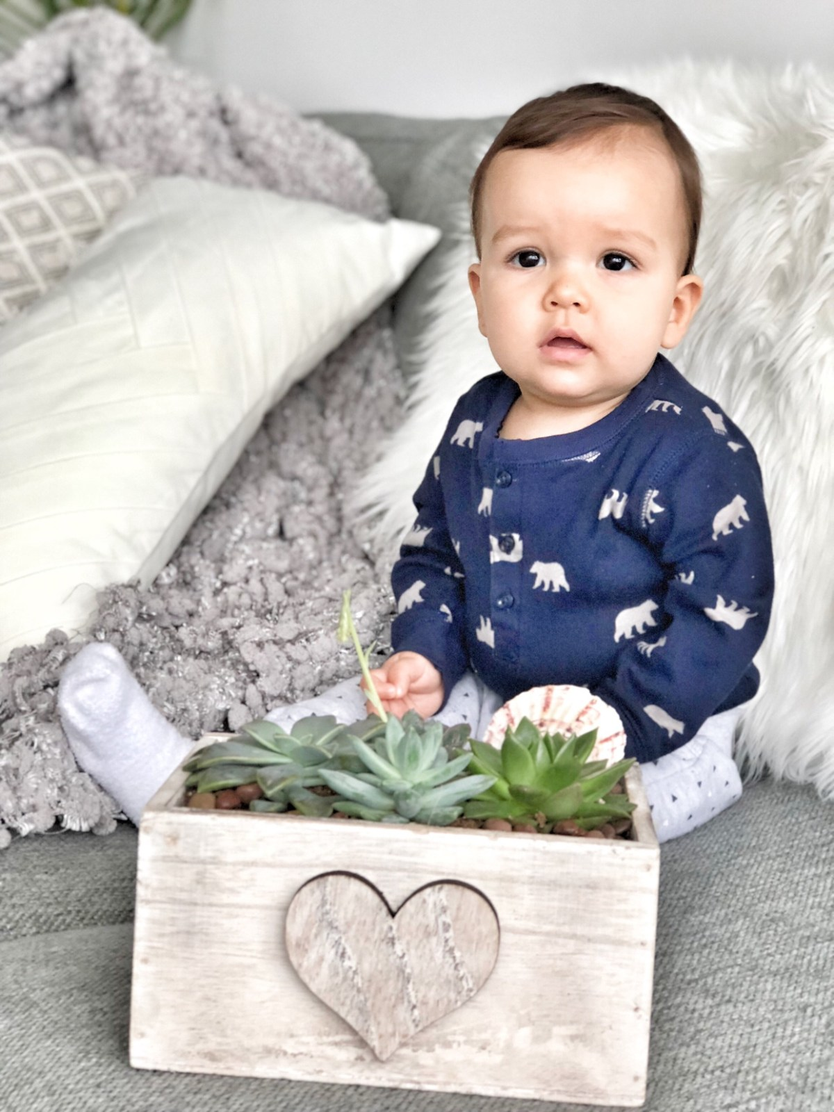 baby with cactus planter