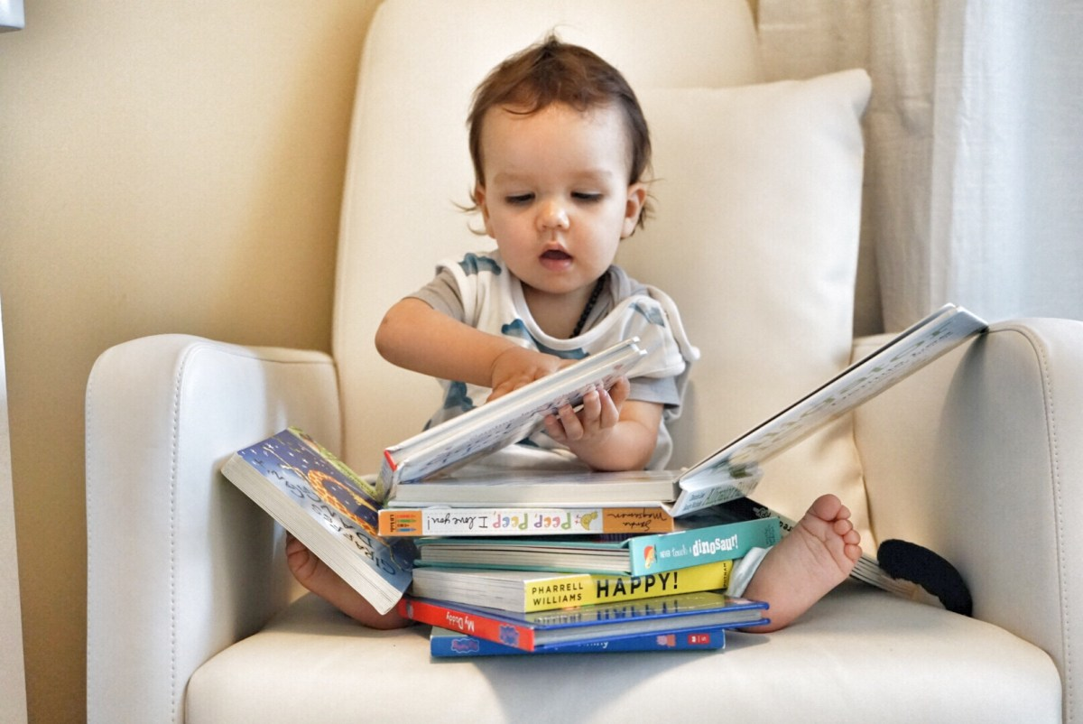 baby is loving his books