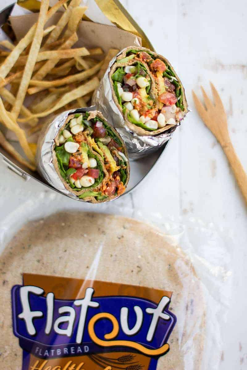 We're packing teen friendly lunches with @FlatOut wraps! Get the recipe for this Best Ever Taco Salad Wrap on @beardandbonnet
