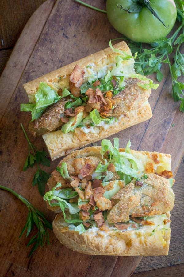 Fried Green Tomato Po'Boys recipe || Whether you are serving this with coconut bacon for a vegetarian sandwich or with real crispy oven baked bacon this sandwich is not to be missed! || @thismessisours