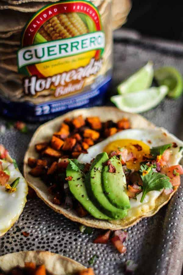 Crave-Worthy Breakfast Tostadas recipe    @GuerreroTortillas baked tostadas have officially made their way to pantry staple status in our home. They make for easy, healthy meals in a flash!    @thismessisours #vegetarian #glutenfree #ad #GuerreroBakedTostadas