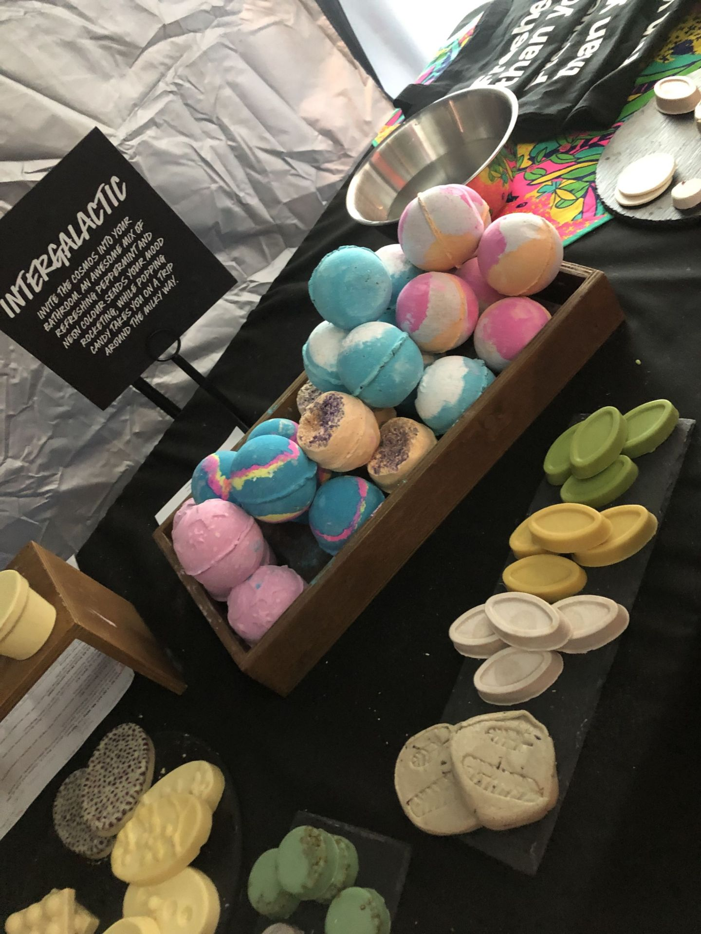 LUSH stand at BlogOn conference. Variety of bath bombs, cleansers, shampoos. LUSH cosmetics.