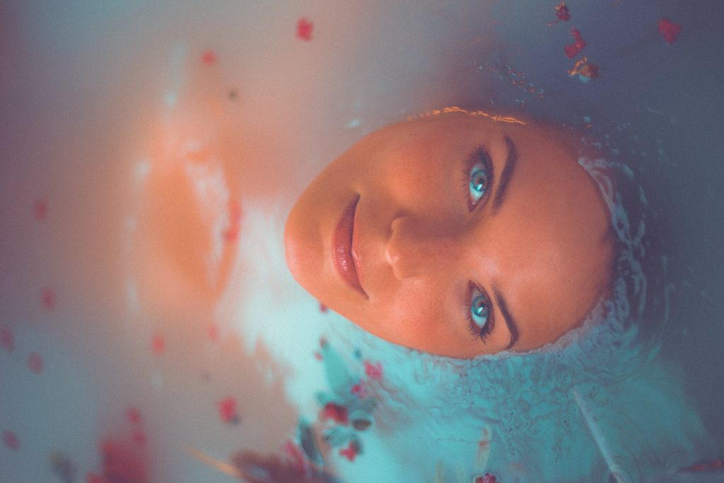 Seeing with clarity a woman with luminous eyes gazes benevolently out of a bath tub