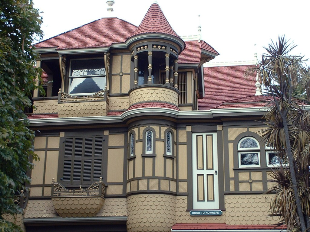 A huge mansion sits with winding turrets and a strange door that leads to nowhere... unless you were a ghost and could fly up to use the door?