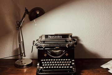 Typewriter with a lamp Courtesy of Unsplash by Yusuf Evli