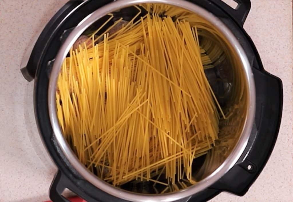 Add Broken Spaghetti to Pot Over Meatballs.