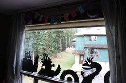 The monsters waving in the window.