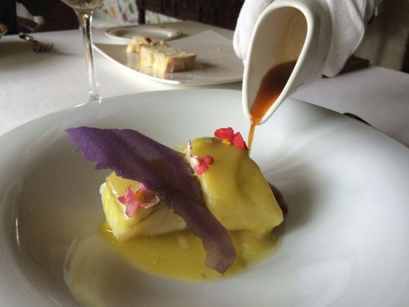 pil pil cod served with mushrooms, a crispy purple potato and pepper juice