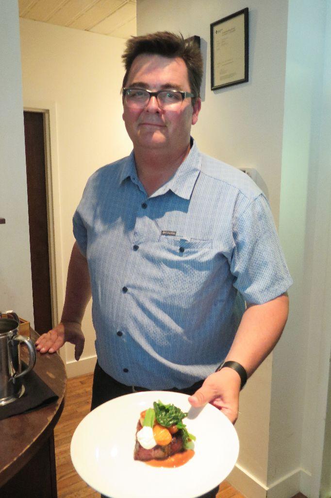 Red Ox Inn owner Frank Olsen serves the Taste Alberta Prairie on a Plate main course.