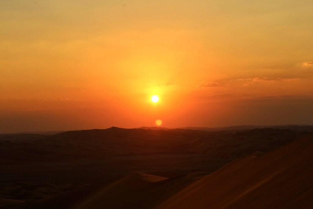 Sunset over the sand dunes in the Arabian Desert.