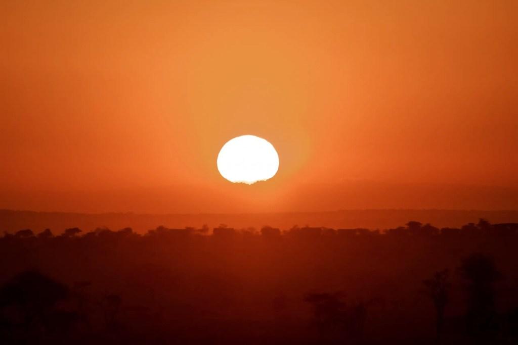 Sunrise in the Serengeti on my Tanzania camping safari