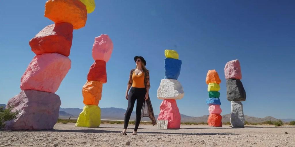 Monica standing in between five of the rock sculptures by Ugo Rondinone.