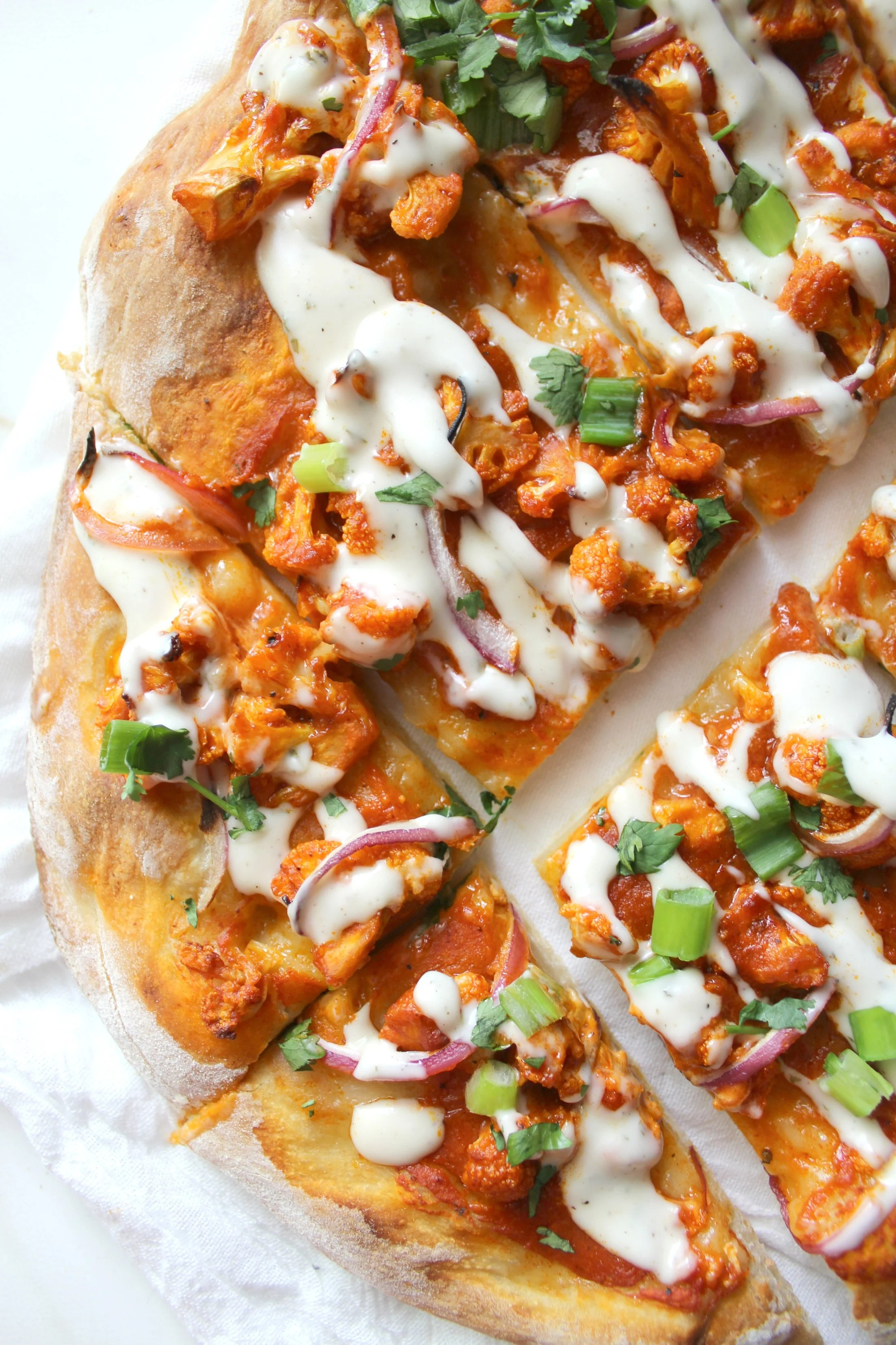 This Vegan Roasted Cauliflower Buffalo Pizza is the perfect balance of spiciness and creaminess with a nice crunch from the cauliflower   ThisSavoryVegan.com