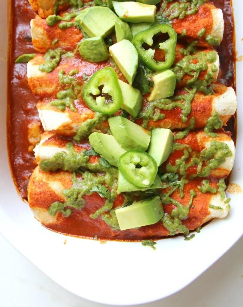 Simple and delicious, theseBlack Bean Potato Vegan Enchiladas with Avocado Cilantro Sauce are the perfect weeknight dinner! | ThisSavoryVegan.com