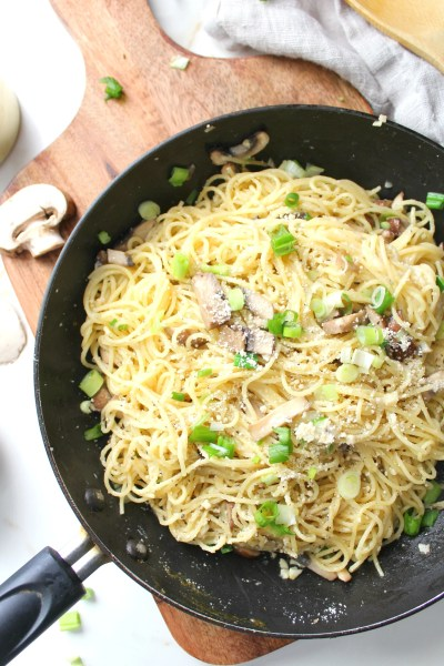 Simple and delicious, theseVegan Mushroom Garlic Parmesan Noodles are a delicious mix of angel hair pasta, sliced mushrooms, fresh garlic and parmesan | ThisSavoryVegan.com #vegan #veganrecipes