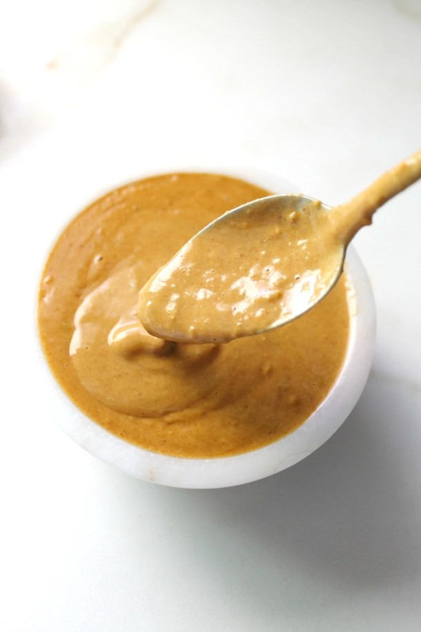 The perfect dip or dressing for salads, spring rolls or rice paper rolls - this Spicy Peanut Sauce is a delicious blend of flavors that is finger licking good   ThisSavoryVegan.com #vegan #peanutsauce #dressing