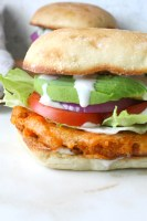 Dripping in flavor, crunch and spice, this is the Ultimate Vegan Buffalo Cauliflower Sandwich! Instructions for both baked and fried versions included | ThisSavoryVegan.com #vegansandwiches #buffalocauliflower #veganrecipes