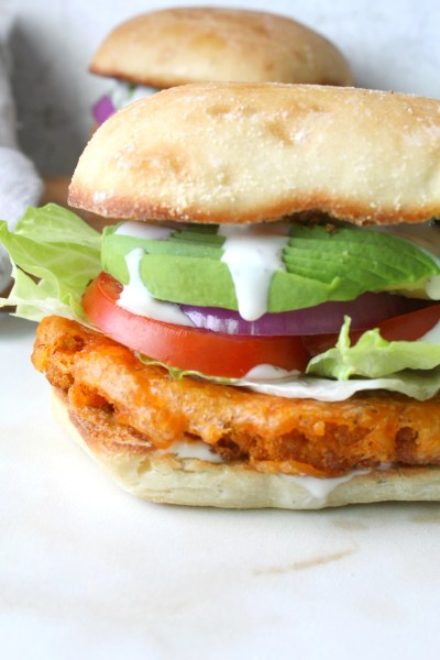 Dripping in flavor, crunch and spice, this is theUltimate Vegan Buffalo Cauliflower Sandwich! Instructions for both baked and fried versions included   ThisSavoryVegan.com #vegansandwiches #buffalocauliflower #veganrecipes