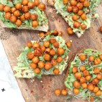 This Roasted Chickpea Avocado Toast steps up the classic vegan breakfast. Toasted bread is topped with smashed avocados, smoky chickpeas and sprouts | ThisSavoryVegan.com #thissavoryvegan #avocadotoast