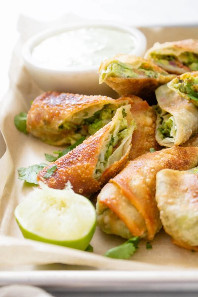 These Avocado Egg Rolls with Vegan Cilantro Ranch are the perfect party appetizer! Perfectly crispy, simple to make and totally tasty   ThisSavoryVegan.com #thissavoryvegan #vegan #eggrolls