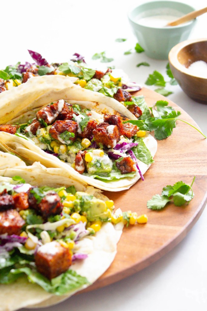 These BBQ Tempeh Tacos with Vegan Ranch are filled with crispy tempeh, avocado salsa, homemade slaw and vegan ranch. The perfect vegan taco | ThisSavoryVegan.com #thissavoryvegan #vegantacos #tempehtacos