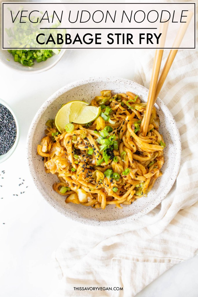 This Vegan Udon Noodle Cabbage Stir Fry is a quick weeknight dinner that is better than take-out. Ready in less than 30 minutes | ThisSavoryVegan.com #thissavoryvegan #veganstirfry #udon