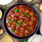 Overhead of meatballs in sauce in pan square image